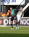 Nederland, Nijmegen, 2 december 2012.Eredivisie .Seizoen 2012-2013.N.E.C.-NAC Breda.Victor Palsson (l.) van N.E.C. en Nemanja Gudelj (r.) van NAC Breda strijden om de bal.