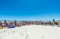 North Kirra, Queensland, Australia. (Sunday, January 19, 2014) &ndash; Current World Surfing Champion Mick Fanning(AUS) and  former World Surfing Champion Joel Parkinson (AUS), who spent their  teenage years honing their  surfing skills at Kirra beach, were joined today by a crowd estimated at close to 3000  people to protest the planned casino and Marina development at Kirra. The protest focused on saving all the Gold Coast beaches from development plans and Public Land grabs and also the push to have the area acknowledged as  World Surfing Reserve. <br />
