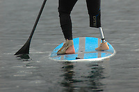 Saturday, 01/24/09.  Campland on the Bay, Mission Bay, San Diego, CA, USA.  Brice Brokow paddles a stand up paddle board across Mission Bay during an event held by the Challenged Athletes Foundation.  The participants had the opportunity to had the opportunity to try several different paddle sports. The Challenged Athletes Foundation established the Operation Rebound fund to provide sports opportunities and support for troops, veterans and first responders who have suffered permanent physical injuries in the line of duty.