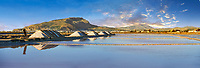 Pictures & images of Pile of sea salt on the edge of the salt pans of the World Wildlife reserve of Saline di Trapani and Paceco site, Trapani Sicily.
