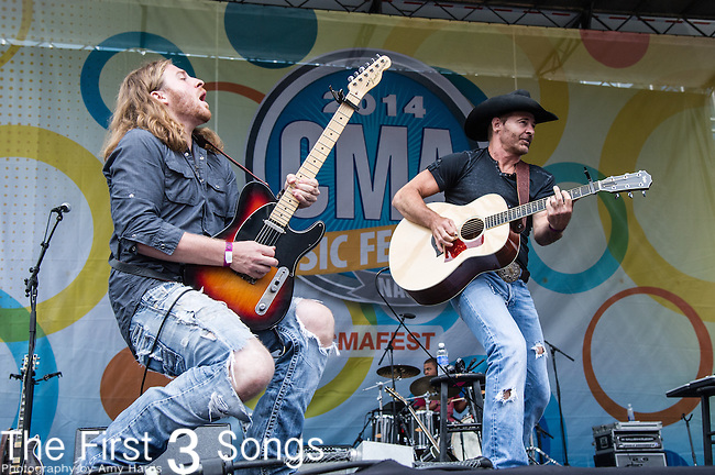 Keith Burns and Ira Dean of Trick Pony performs on Day One of the 2014 CMA Music Festival in Nashville, Tennessee.