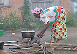 A woman cooks breakfast in the Congolese village of Wembo Nyama.