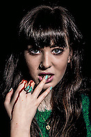 A series of fashion portraits with a twist. The use of special FX makeup has transformed these somewhat normal beauty shots into something dark and almost disturbing. The models are somehow oblivious to their mutilations, which adds humour to the whole concept.         Caption: Elise wears chunky green ring from a car boot sale. £1.50