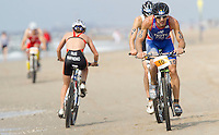 13 JUL 2013 - DEN HAAG, NED - Nicolas Tauty (FRA) (right) of France races along the beach during the bike at the 2013 ITU Elite Men's Cross Triathlon World Championships in Kijkduin, Den Haag (The Hague), the Netherland (PHOTO COPYRIGHT © 2013 NIGEL FARROW, ALL RIGHTS RESERVED)