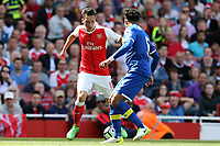 Mesut Ozil of Arsenal and Ashley Williams of Everton during Arsenal vs Everton, Premier League Football at the Emirates Stadium on 21st May 2017