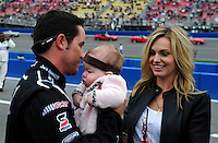 Feb 22, 2009; Fontana, CA, USA; NASCAR Sprint Cup Series driver Casey Mears holds daughter Samantha Mears as mother Trish Grablander looks on prior to the Auto Club 500 at Auto Club Speedway. Mandatory Credit: Mark J. Rebilas-