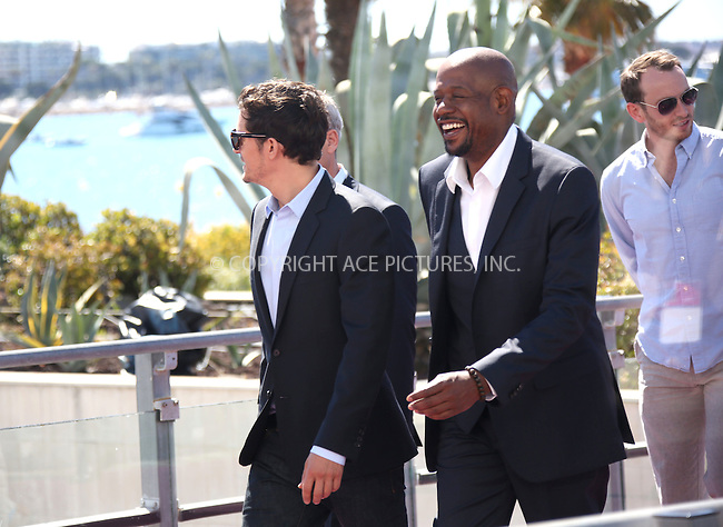 WWW.ACEPIXS.COM....US Sales Only....May 26 2013, Cannes....Orlando Bloom and Forest Whitaker at the photocall for 'Zulu' during the Cannes Film Festival on May 26 2013  in France ....By Line: Famous/ACE Pictures......ACE Pictures, Inc...tel: 646 769 0430..Email: info@acepixs.com..www.acepixs.com