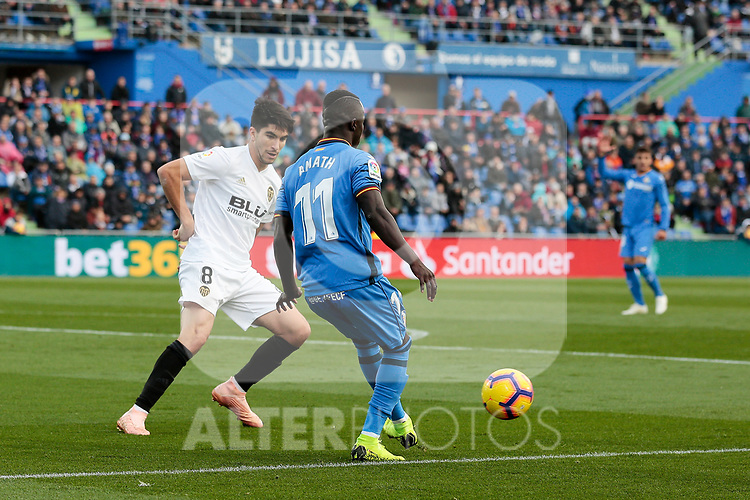 Getafe CF's Amath Ndiaye and Valencia CF's Carlos Soler during La Liga match between Getafe CF and Valencia CF at Coliseum Alfonso Perez in Getafe, Spain. November 10, 2018.