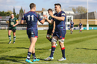 Jason Harries of London Scottish (11) celebrates with Dave Sisi of London Scottish (right) after he scores a try during the Greene King IPA Championship match between London Scottish Football Club and Nottingham Rugby at Richmond Athletic Ground, Richmond, United Kingdom on 15 April 2017. Photo by David Horn.