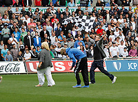 Npower Championship, Swansea City FC (white) V Sheffield United. Sat 7th May 2011 (12.45pm KO)<br /> Pictured: Swans fans rush onto the pitch after the final whsitle<br /> Picture by: Ben Wyeth / Athena Picture Agency<br /> info@athena-pictures.com<br /> 07815 441513