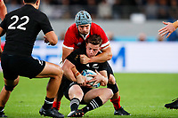 1st November 2019, Tokyo, Japan;   Jonathan Davies (WAL) holds up the push from Brad Weber (NZL);  2019 Rugby World Cup 3rd place match between New Zealand 40-17 Wales at Tokyo Stadium in Tokyo, Japan.  - Editorial Use