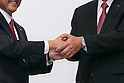 (L to R) Toyota Motor Corporation President Akio Toyoda and Mazda Motor Corporation President and CEO Masamichi Kogai, shake hands during a news conference at the Royal Park Hotel Tokyo on August 4, 2017, Tokyo, Japan. Toyoda and Kogai announced an alliance between the car makers; whereby they will invest in each other and plan to build a joint auto factory in the U.S. and cooperate in new technologies for electric vehicles. (Photo by Rodrigo Reyes Marin/AFLO)