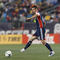 New England Revolution substitute midfielder Andy Dorman (12) passes the ball. In a Major League Soccer (MLS) match, the New England Revolution (blue) tied New York Red Bulls (white), 1-1, at Gillette Stadium on May 11, 2013.