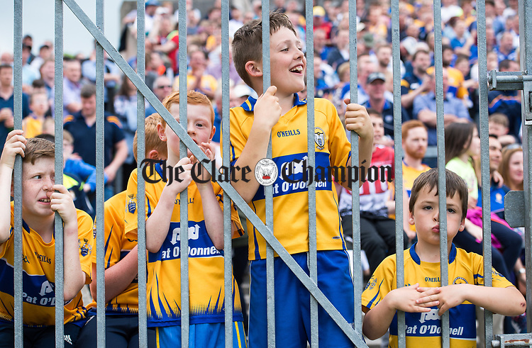 Young Clare fans watch their eam play Waterford in their Munster  championship round robin game at Cusack Park Photograph by John Kelly.