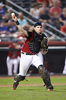 Hickory Crawdads catcher Sam Huff (27) makes a throw to first base against the Kannapolis Intimidators at L.P. Frans Stadium on July 20, 2018 in Hickory, North Carolina. The Crawdads defeated the Intimidators 4-1. (Brian Westerholt/Four Seam Images)