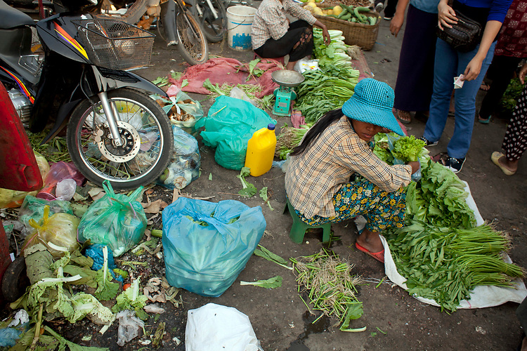 Unsanitary conditions in a marketplace in Phnom Penh, Cambodia. <br /> <br /> Photos &copy; Dennis Drenner 2013.