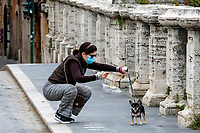 A woman takes pictures to her dog during Italy's lockdown due to Covid-19 pandemic. <br /> Rome 30/04/2020 <br /> Photo Andrea Staccioli Insidefoto