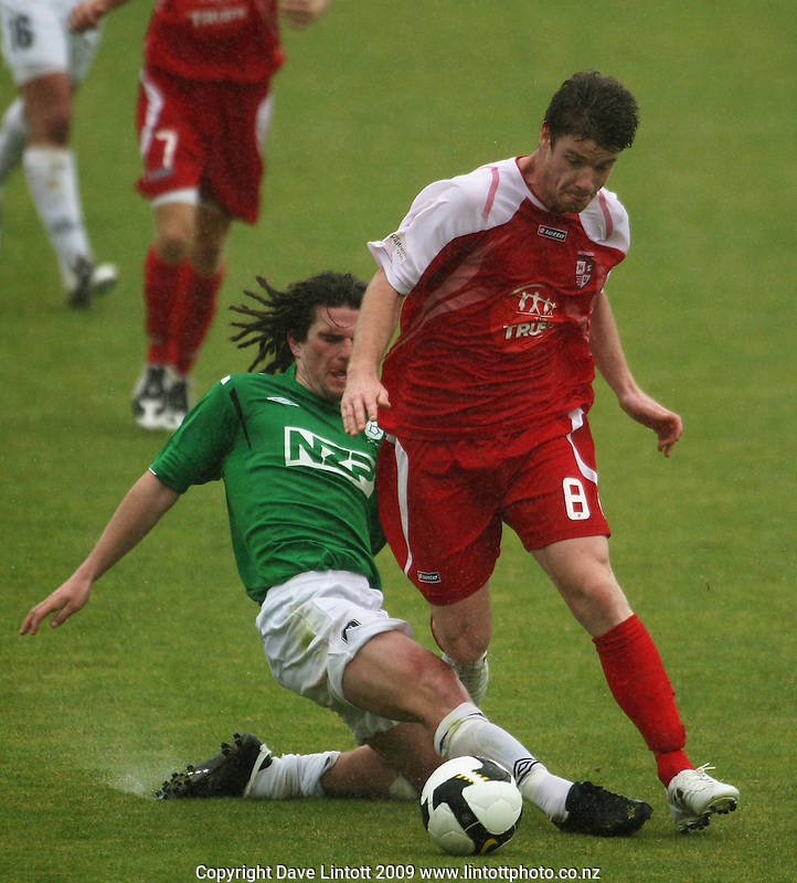 Manawatu's Nathan Cooksley tries to tackle Brent Fisher..NZFC Championship soccer - Youngheart Manawatu v Waitakere United at Memorial Park, Palmerston North. Sunday, 15 November 2009. Photo: Dave Lintott/lintottphoto.co.nz