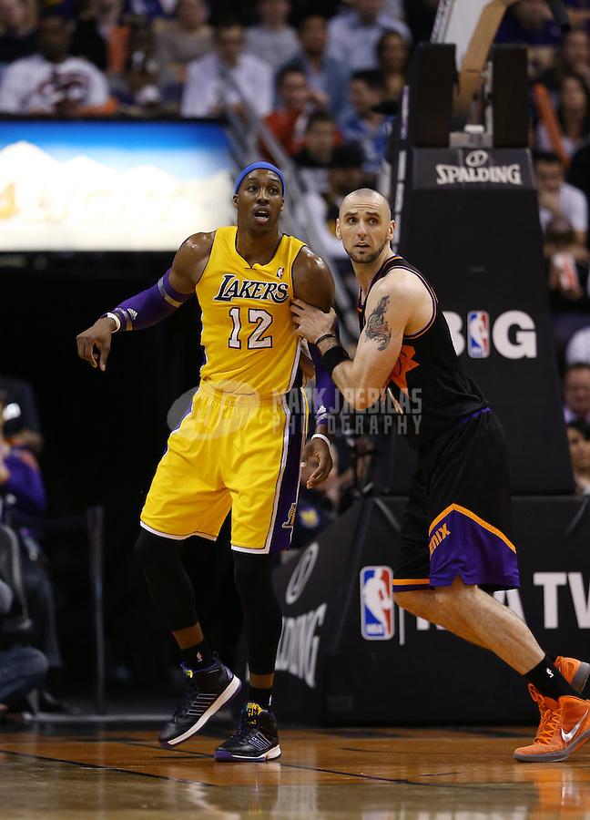 Jan. 30, 2013; Phoenix, AZ, USA: Los Angeles Lakers guard Kobe Bryant (24) against Phoenix Suns center Marcin Gortat at the US Airways Center. Mandatory Credit: Mark J. Rebilas-
