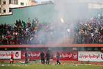 Palestinian fans light flares during a a football match between Palestinian Shabab Rafah football club players (in blue) and Shejaiya's football club players (in green) at Palestine Stadium in Gaza city on March 4, 2018. Photo by Mahmoud Ajour