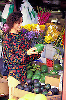 Woman shopping for fruit at an Oahu market in Chinatown