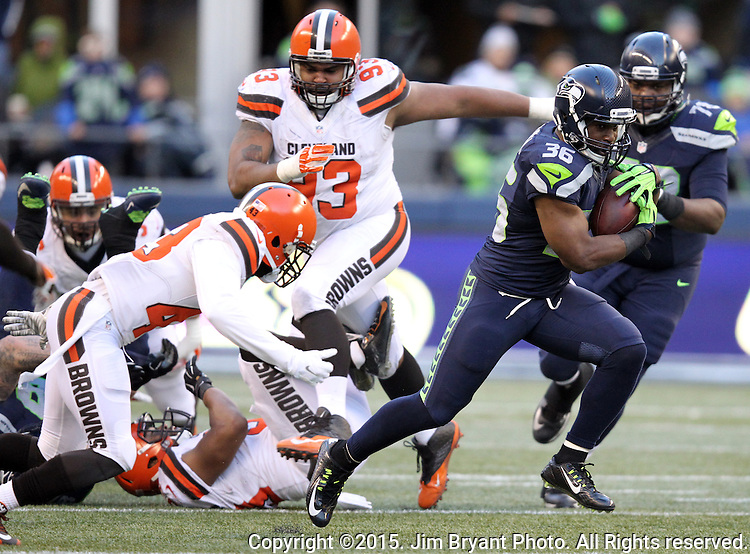 Seattle Seahawks, running back Bryce Brown runs against the Cleveland Browns at CenturyLink Field in Seattle, Washington on December 20, 2015. The Seahawks clinched their fourth straight playoff berth in four seasons by beating the Browns 30-13.  ©2015. Jim Bryant Photo. All Rights Reserved.