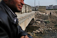 "The ""River of Martyr's"" the name given to the Qweiq river that divides most of the rebel-controlled sections of Aleppo from the regime strongholds in the city was renamed earlier this year after 110 bodies washed up under a bridge. Most of them showed signs of torture and almost all of them were executed with their hands bound behind their backs. Hundreds of people claim to have missing relatives, most of whom disappeared in the regime-controlled areas of the city, as work and commerce are only found in these areas. Everyday, thousands of civilians who live in the Free Syria Army side of the city travel to the regime areas to work (or to seek employment). Dozens are shot by regime snipers while commuting to and from the government controlled areas of the city. Some do not return at all. Every morning, dozens of civilians walk down to the banks of the canal to see if there are any new bodies washing up. For some, this is their daily routine - the daily stroll to the water canal in search of the body of their missing loved ones."
