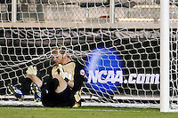 Akron Zips goalkeeper David Meves (24) sits in the back of the net after making a save. The Akron Zips defeated the North Carolina Tar Heals 5-4 in penalty kicks after playing a scoreless game during the second semi-final match of the 2009 NCAA Men's College Cup at WakeMed Soccer Park in Cary, NC on December 11, 2009.