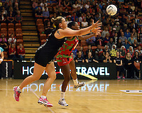 27.10.2013 Silver Fern Cathrine Latu and Malawi's Towela Vinkhumbo in action during the Silver Ferns V Malawi New World Netball Series played at the Pettigrew Green Arena in Napier. Mandatory Photo Credit ©Michael Bradley.