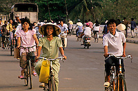 Cyclists crossing a bridge, Hue, Vietnam.