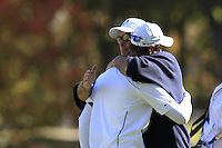 European Team Player Nicolas Colsaerts (BEL) gets a hug from Vice Captain Thomas Bjorn after conceding the match to USA's Dustin Johnson on the 16th green during Sunday's Singles Matches of the 39th Ryder Cup at Medinah Country Club, Chicago, Illinois 30th September 2012 (Photo Colum Watts/www.golffile.ie)