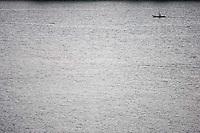 Man in boat on Lake Atitlán in Santiago Atitlán, Guatemala on Tuesday, Nov. 1, 2005.
