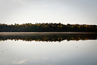 Mississauga Lake reflection of distant coastline in the water.