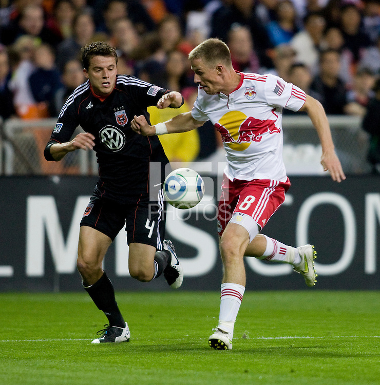 Marc Burch (4) of D.C. United fights for the ball with Jan Gunnar Solli (8) of the New York Red Bulls during the game at RFK Stadium in Washington, DC.  D.C. United lost to the New York Red Bulls, 4-0.