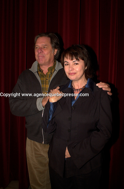 Montreal (Qc) CANADA -  2002  File Photo <br /> Pierre Curzi (L), Dorothee Berryman (R)<br /> Set of Denys Arcand BARBARIAN INVASIONS (Les Invasions Barbares) in Montreal Museum of Fine Arts converted into a London art auction.<br /> Photo by Images Distribution.