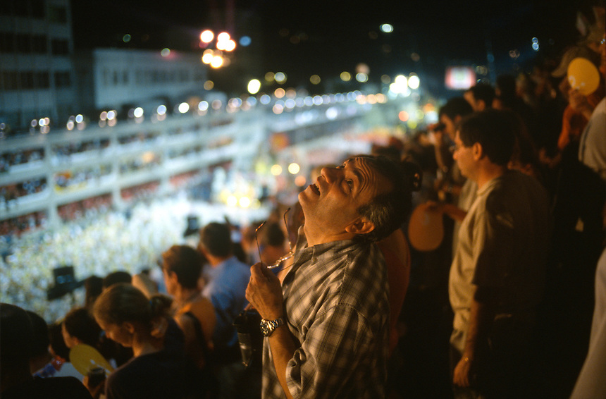 A tourist watches the stars above carnaval parades in Rio de Janeiro's Sambadrome parade avenue.