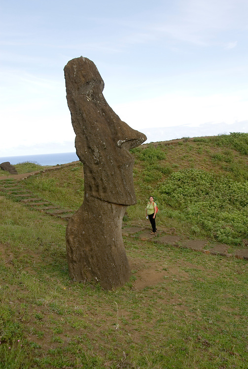 Chile, Easter Island: Sculptures at the quarry Rano Raraku where all the large sculptures were carved..Photo #: ch257-32713.Photo copyright Lee Foster www.fostertravel.com lee@fostertravel.com 510-549-2202