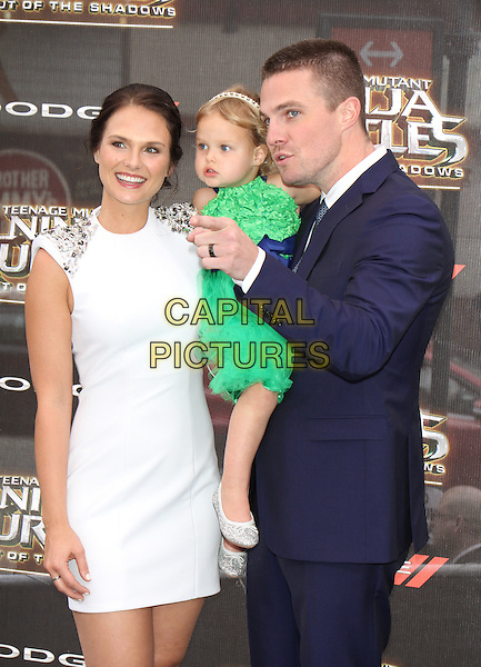 NEW YORK, NY-May 22:  Cassandra Jean, Mavi Amell, Stephen Amell at Paramount Pictures, Nickelodeon Movies and Dodge present the WORLD premiere of TEENAGE MUTANT NINJA TURTLES: OUT OF THE SHADOWS! at Madison Square Garden New York. NY May 22, 2016. <br /> CAP/MPI/RW<br /> &copy;RW/MPI/Capital Pictures