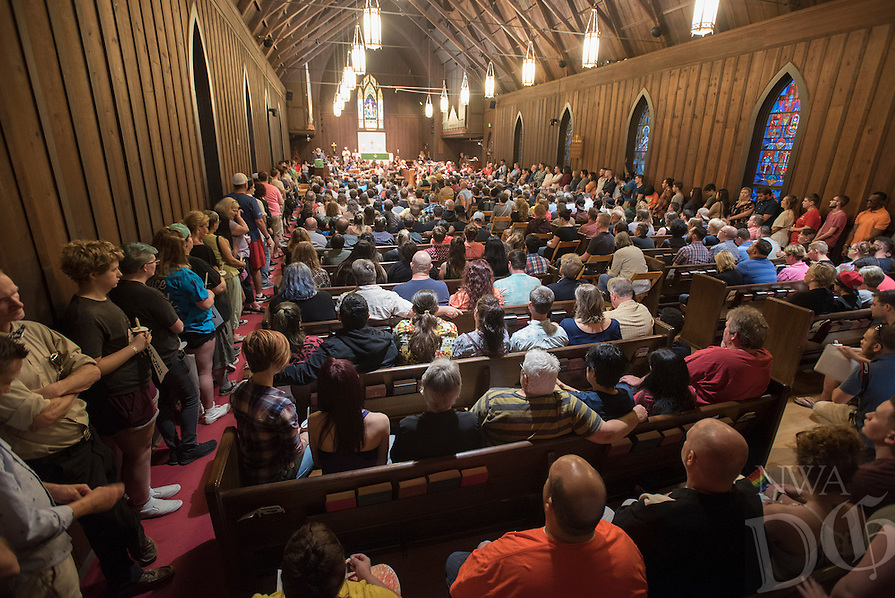 NWA Democrat-Gazette/J.T. WAMPLER A standing room only crowd listens to Rev. Lowell Grisham Sunday June 12, 2016 at St. Paul's Episcopal Church in Fayetteville during a vigil for the victims of the Orlando shooting. Around 500 people attended the vigil and marched down Dickson St.