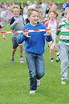 Cory Flynn winning the boys under 11 race at O'Raghallaigh's fun day. Photo: Colin Bell/pressphotos.ie