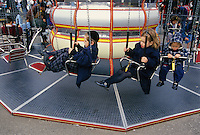 Orthodox Jewish Children, Hassidim, play on one of the carousels at Astroland, during Passover trip.