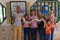 Malaysia, Penang. Snake Temple. Souvenir photo with tiger python.