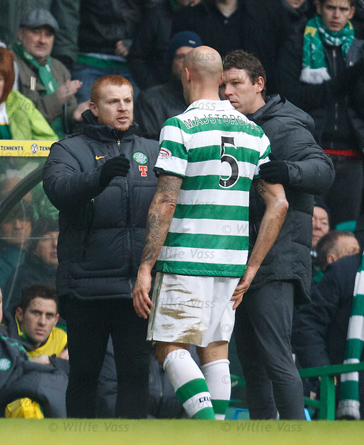 Celtic's Daniel Majstorovic goes off the park with an injury