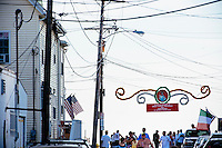 Powerlines and banners hang above Beach Court street during St. Peter's Fiesta in Gloucester, Massachusetts, USA.