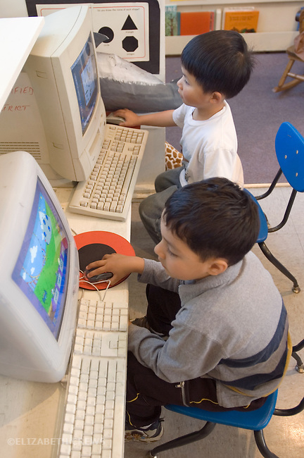 Berkeley CA  Boys doing learning games on computers in preschool classroom.