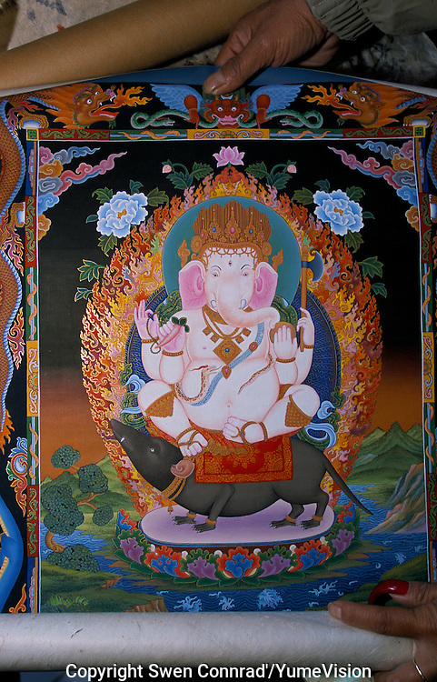 Ganesha Thangka on a Chinese style in one of many Thangka shop in Durbari Square in Kathmandu. The lamas who paint thangkas use painting as a form of spiritual education and can spend up to 9 months on each canvas. Thangkas are seen hanging in every temple, monastery and family shrine in Tibet and Nepal.