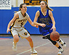 Alyssa Adomaites #23 of Glenn, right, dribbles downcourt as Shea Cronin #5 of Northport guards her during a Suffolk Shootout tournament game at Northport High School on Thursday, Dec. 28, 2017. Adomaites scored a team-high 14 points for Glenn. Northport won by a score of 65-35.