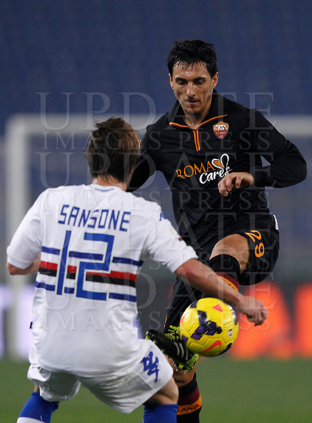 Calcio, ottavi di finale di Coppa Italia Tim: Roma vs Sampdoria. Roma, stadio Olimpico, 9 gennaio 2014.<br /> AS Roma defender Nicolas Burdisso, of Argentina, is challenged by Sampdoria forward Gianluca Sansone, left, controls the ball during the Italy Cup round of sixteen football match between AS Roma and Sampdoria at Rome's Olympic stadium, 9 January 2014.<br /> UPDATE IMAGES PRESS/Isabella Bonotto