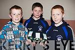 PROUD: John B O'Shea, Darragh McGarty and Padraig O'Connor who were presented their under 13 medals by O'Halpi?n on Friday night in St Brendan's Community Centre,Ardfert.................................. ....