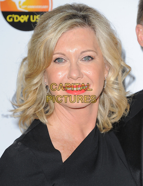 Olivia Newton John.at The G'Day USA Black Tie Gala held at The JW Marriot at LA Live in Los Angeles, California, January 12th 2013.                                                                 .portrait headshot red lipstick make-up beauty black .CAP/DVS.©Debbie VanStory/Capital Pictures.